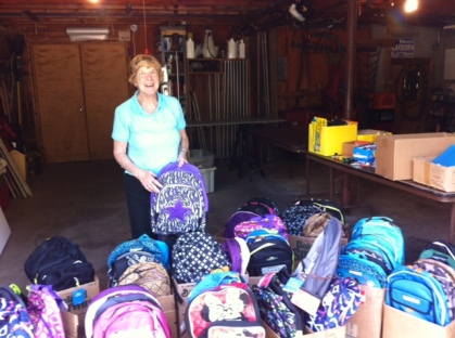 Kathy Rugg with some 68 Backpacks ready for delivery.